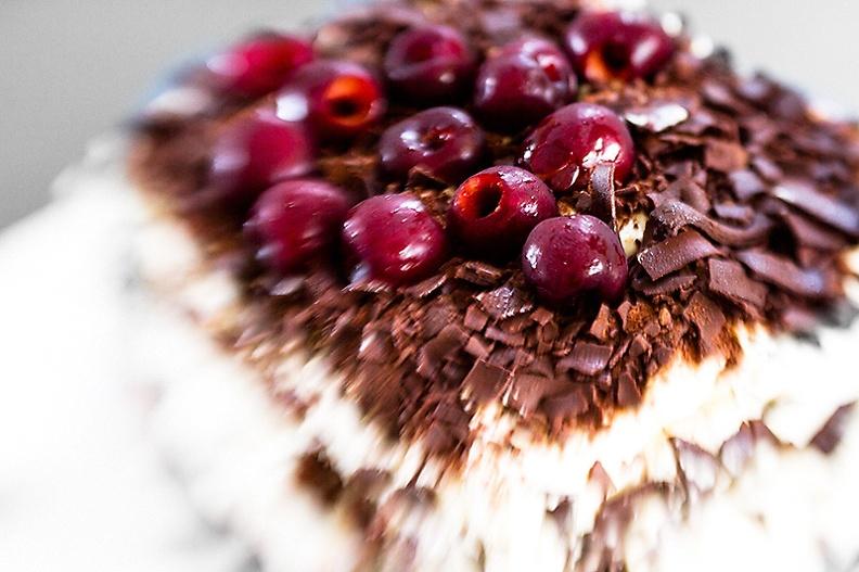 Home made chocolate pie with fresh cherries.