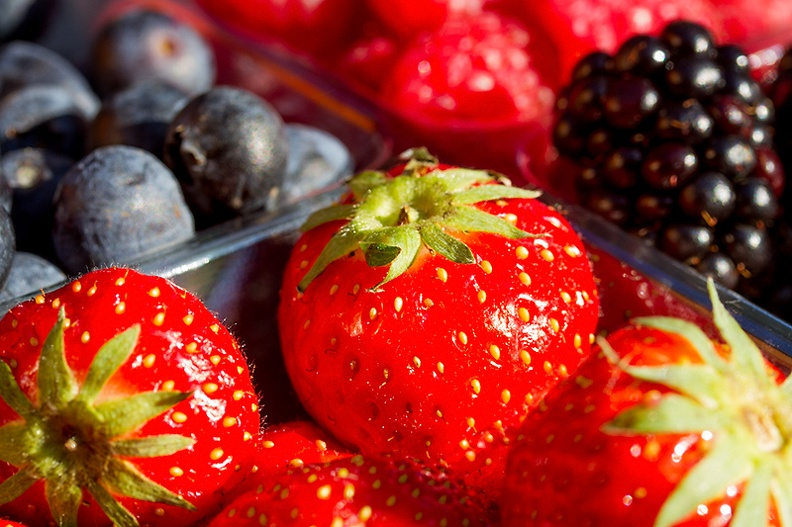 Fruit in the evening sun. Strawberries, raspberries, blueberries and blackberries. Part of my dessert tonight.