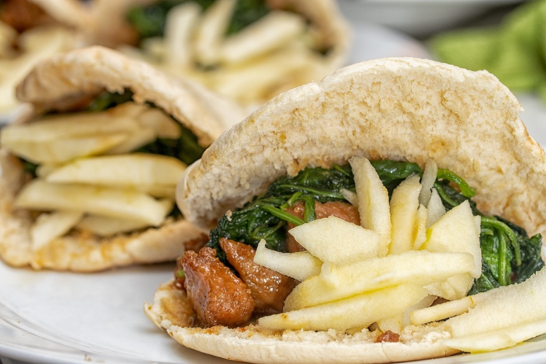 Pita bread, filled with (marinated) schnitzel, fresh spinach (baked) and apple.