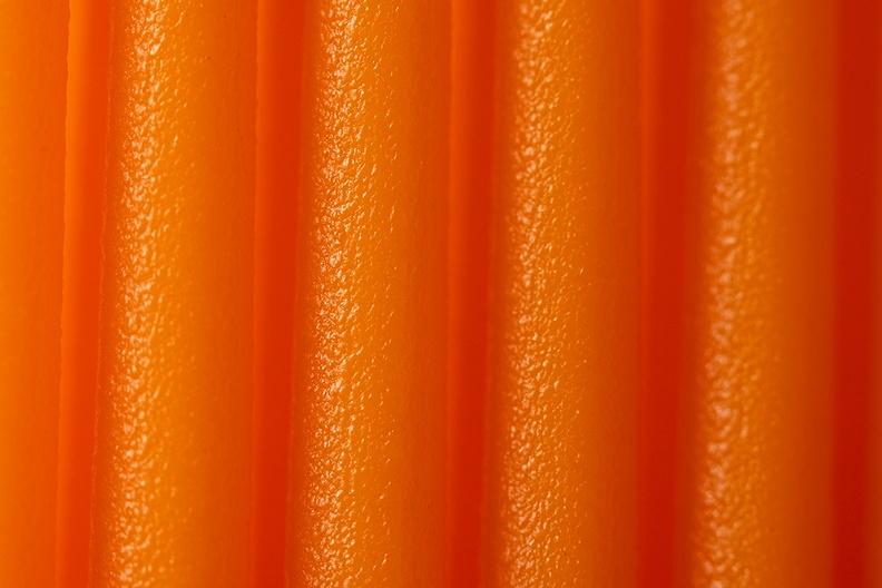 Detail of an orange pastry brush